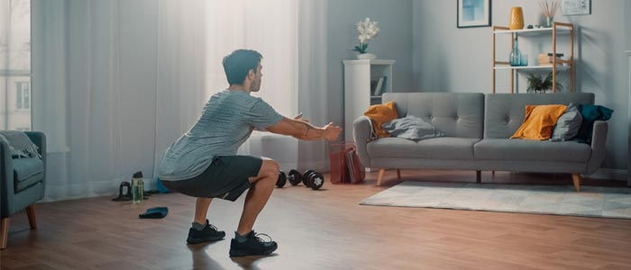 Person squatting in living room