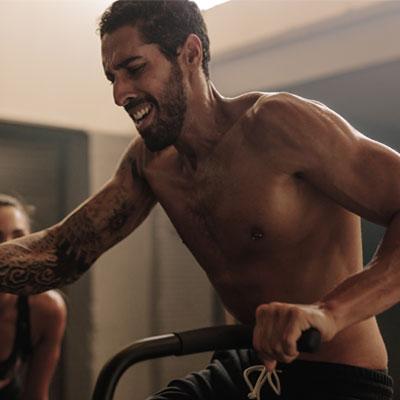 Man doing an assault bike workout