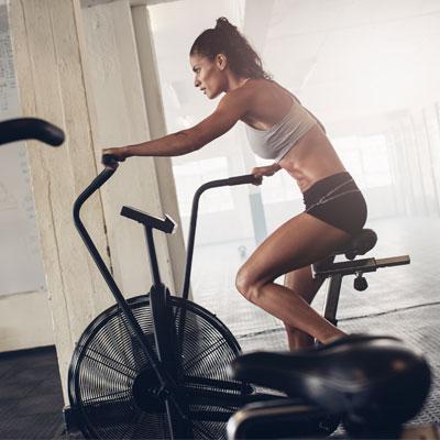 Woman doing an assault bike workout