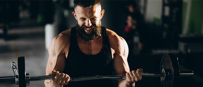 Man struggling during weight training
