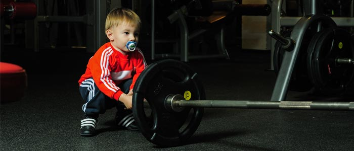 Child racking a barbell