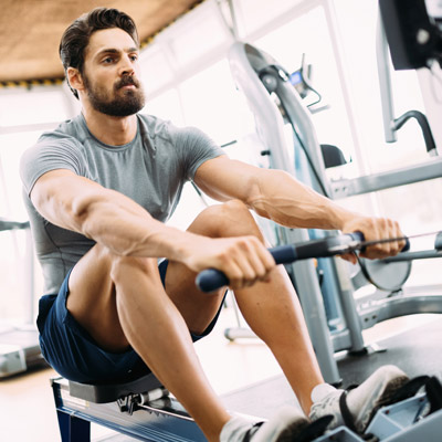person using a rowing machine for weight loss
