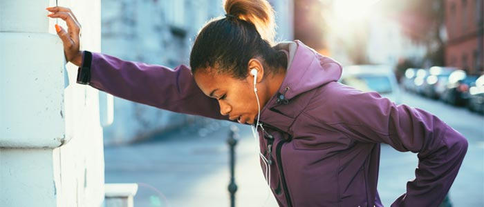 Woman out of breath while jogging