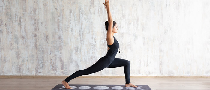 Person doing the warrior yoga pose