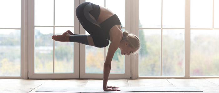 person doing a handstand yoga pose