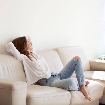 person resting on their sofa