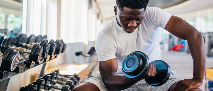 Person bicep curling a dumbbell