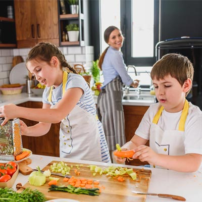 parent and children cooking healthy food
