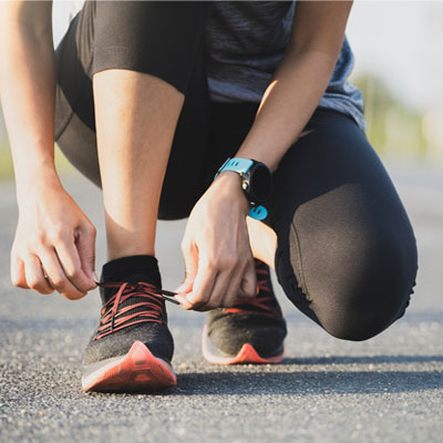 Person tying running shoes