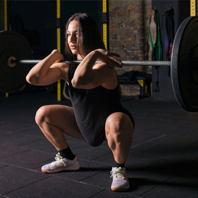 Person doing functional strength training with a barbell