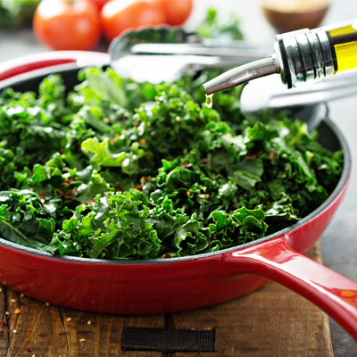 pan of kale and oil