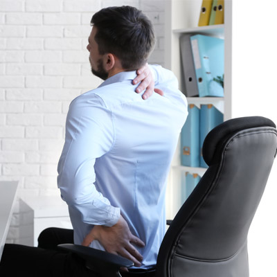 Person sitting down with bad posture