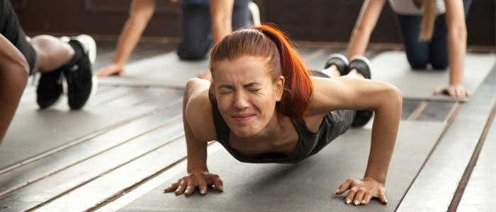 Person struggling to do push ups