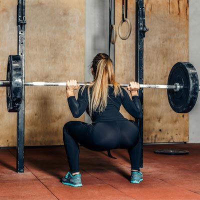 Person squatting a barbell