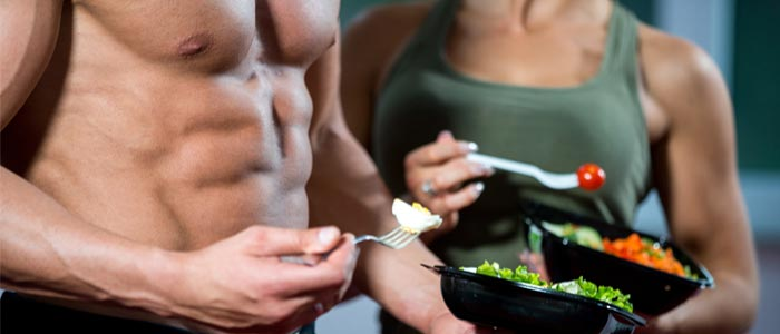 Muscular people eating healthily