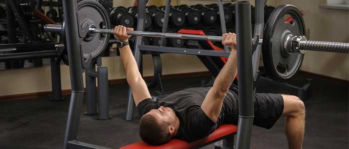 Person doing bench press exercise
