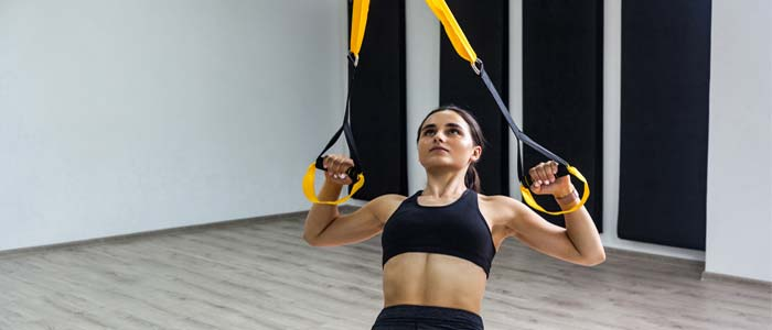Person doing trx rows