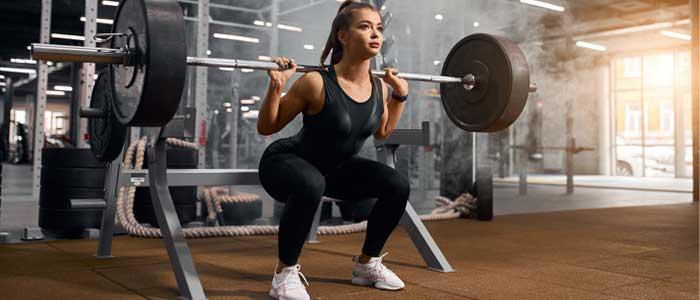 Person squatting barbell