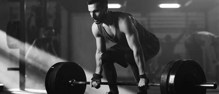 Person deadlifting barbell