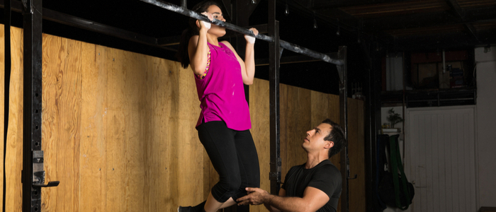 Person doing forced rep pull ups