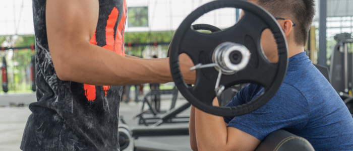 Person doing forced bicep curl reps