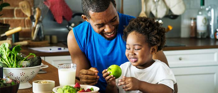 Man and child preparing a healthy meal together