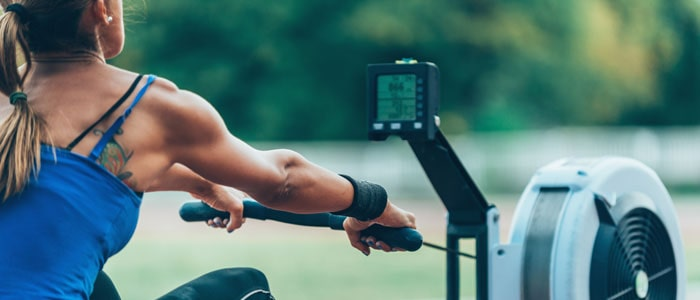 Woman doing a rowing machine workout