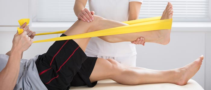 man using resistance band for recovery