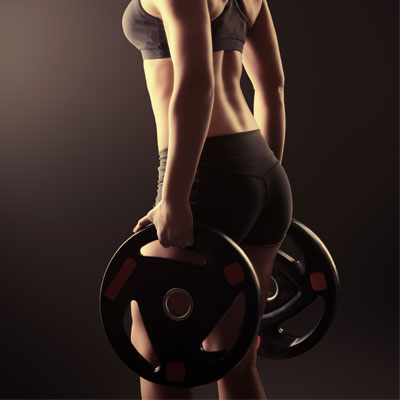Woman holding weight plates