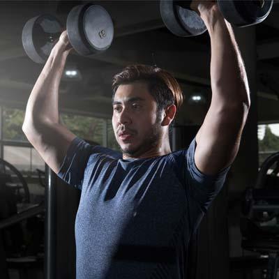 man doing dumbbell shoulder press