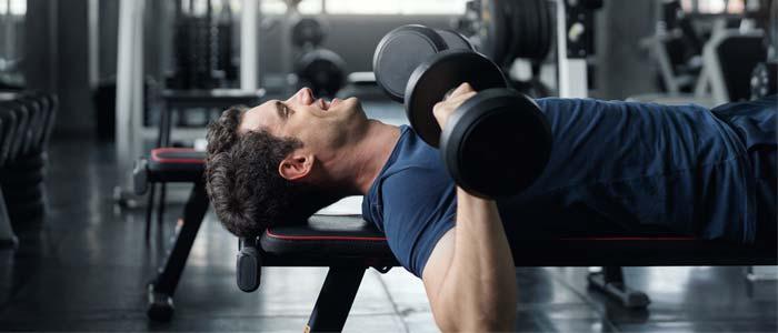 Man chest pressing dumbbells
