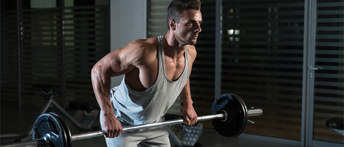 Man performing a bent row compound exercise