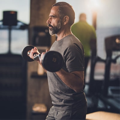 person exercising in a gym with a shiver bar