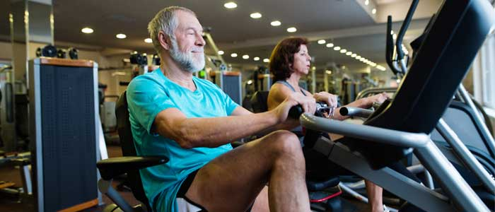 Older person using a recumbent exercise bike