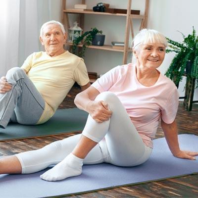 Couple using yoga equipment