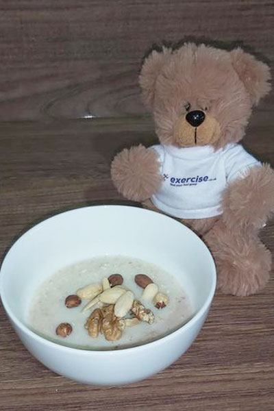 PT the bear eating a healthy breakfast of porridge and nuts