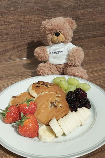 PT the bear eating a healthy breakfast of pancakes and fruit