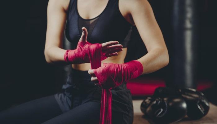 Boxing beginner using hand wraps