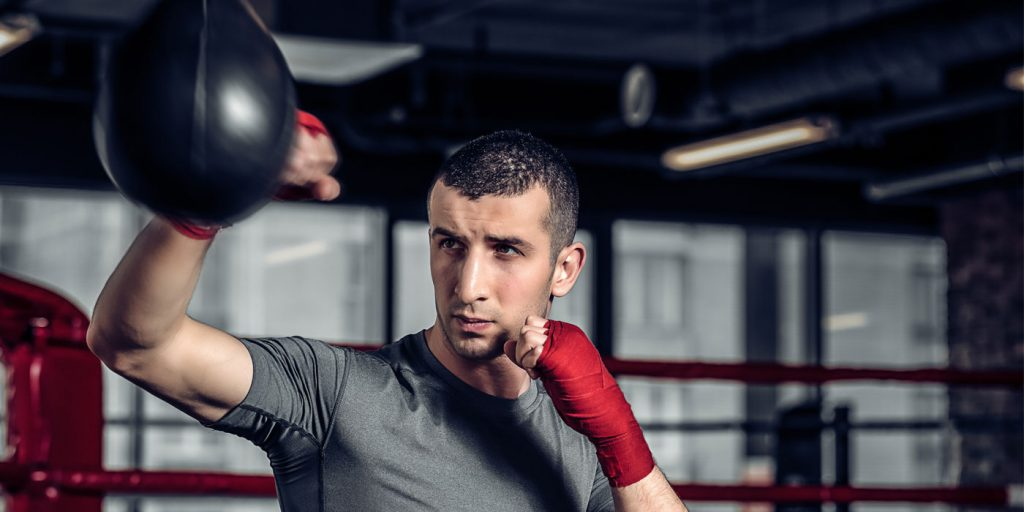 man in hand wraps training with a speed bag
