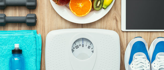 Scales for weight management, and water bottle/trainers for health and fitness