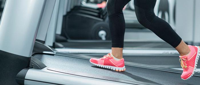womens legs on a treadmill