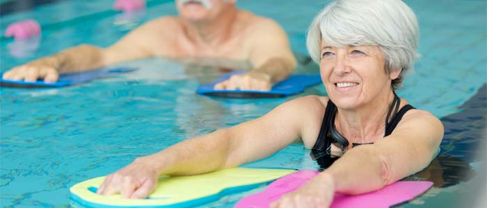 woman with swimming floats at the pool