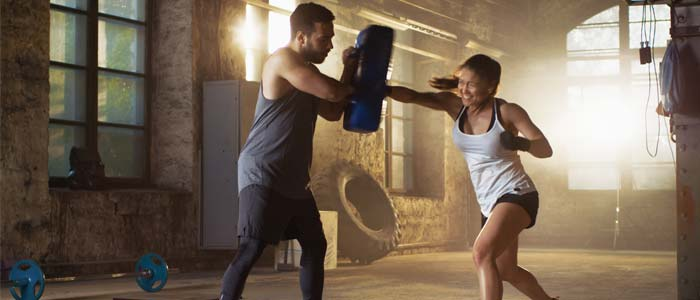woman training with a personal trainer