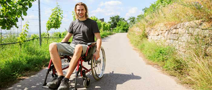 man in a wheelchair exercising with a disability
