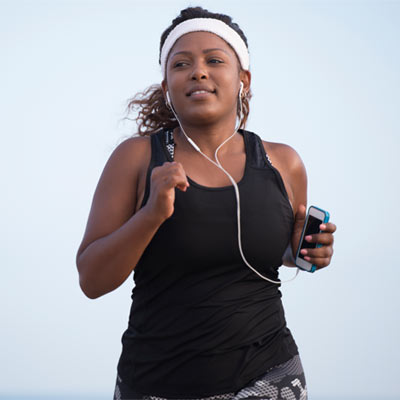 woman running with headphones in
