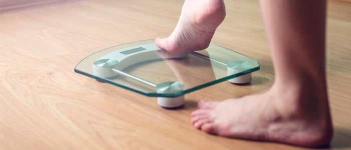 Person stepping onto scales