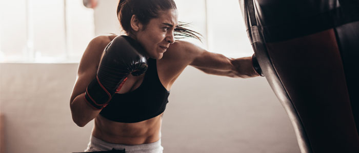 woman training with a boxing bag