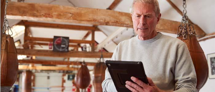 older man using a tablet