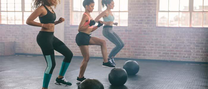 three women training with gym balls