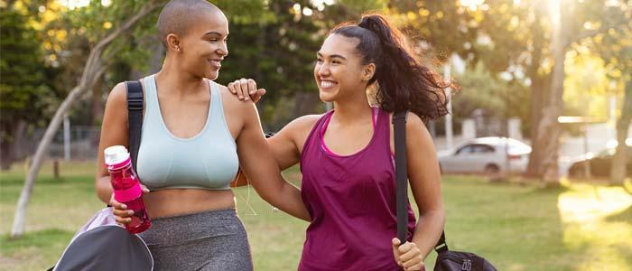 two women walking outside